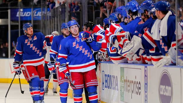 Brad Richards, front, of the New York Rangers celebrates with teammates on the bench after he scored a goal on Saturday.