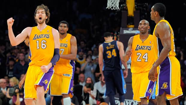 Los Angeles Lakers forward Pau Gasol, left, reacts after scoring as centre Andrew Bynum second from left, guard Kobe Bryant, second from right, forward Metta World Peace look on along with Denver Nuggets centre JaVale McGee during the second half in Game 7 on Saturday in Los Angeles. The Lakers won 96-87.