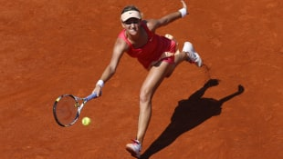 Victoria Azarenka hits a forehand return in Monday's 6-7, 6-4, 6-2 victory over Alberta Brianti.