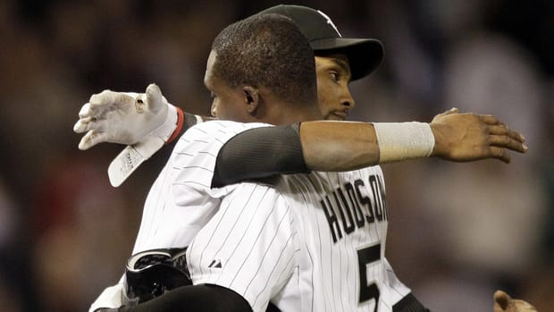 Chicago White Sox's Orlando Hudson, right, celebrates with Alexei Ramirez after hitting a game-winning single against the Toronto Blue Jays in the ninth inning on Thursday night.