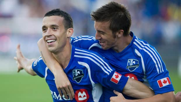 Montreal Impact's Felipe, left, celebrates with teammate Jeb Brovsky after scoring against the Seattle Sounders' during the first half in Montreal on Saturday.