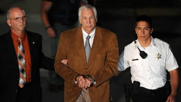 Jerry Sandusky leaves the Centre County Courthouse in handcuffs after being found guilty in his sexual abuse trial, in Bellefonte, Pa.