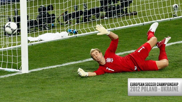 England goalkeeper Joe Hart deflects a shot by Italy's Antonio Nocerino, unseen, during the Euro 2012 soccer championship quarterfinal match between England and Italy in Kiev, Ukraine on Sunday.