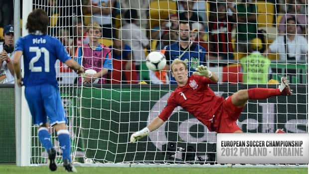 Italian midfielder Andrea Pirlo (21) sends a perfect chip past England goalkeeper Joe Hart during the penalty kicks portion of the Euro 2012 quarter-final match Sunday in Kiev.