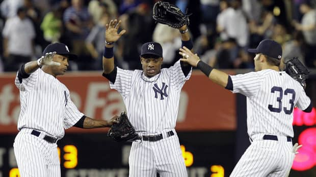 From left, New York Yankees left-fielder Dewayne Wise, centre-fielder Curtis Granderson, and right-fielder Nick Swisher celebrate their 6-4 win over the Cleveland Indians on Tuesday.