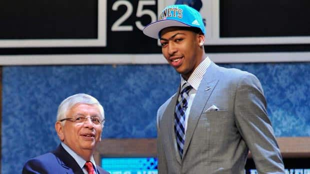 Anthony Davis gets greeted to the NBA by commissioner David Stern after going first overall in the draft. Mel Evans/Associated Press