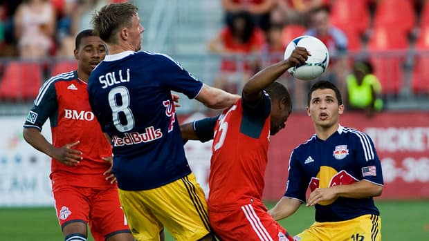 New York Red Bulls Jonathan Borrajo, right, eyes the ball as Toronto FC Jeremy Hall heads it during the first half in Toronto on Saturday.