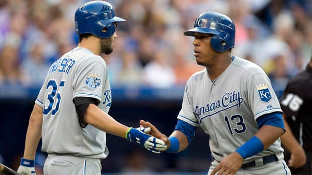 Kansas City Royals catcher Salvador Perez, right, is congratulated by teammate Eric Hosmer after scoring a run in the third inning against the Toronto Blue Jays Thursday night at Rogers Centre.