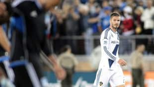 L.A. forward David Beckham, right, was given a yellow card during the Galaxy's loss to San Jose on Saturday when he kicked the ball at injured Earthquakes midfielder Sam Cronin.