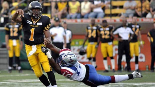 Hamilton Tiger-Cats quarterback Henry Burris throws the ball under pressure from Montreal Alouettes' Rod Davis on Saturday.