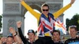 Bradley Wiggins celebrates with teammates and team members of British Sky cycling team during his parade in front of the Arc de Triomphe on Sunday.