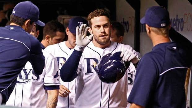 Tampa Bay Rays third baseman Evan Longoria is congratulated by teammates after his sacrifice fly during the third inning against the Toronto Blue Jays on Tuesday night.