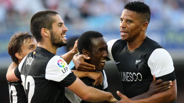 Malaga CF's Fabrice Olinga, centre, celebrates with teammates after scoring a goal against Celta.