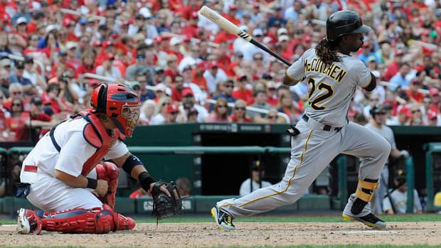Pittsburgh Pirates' Andrew McCutchen, right,  hits a one-run single which scored Jeff Karstens during the sixth inning on Sunday.