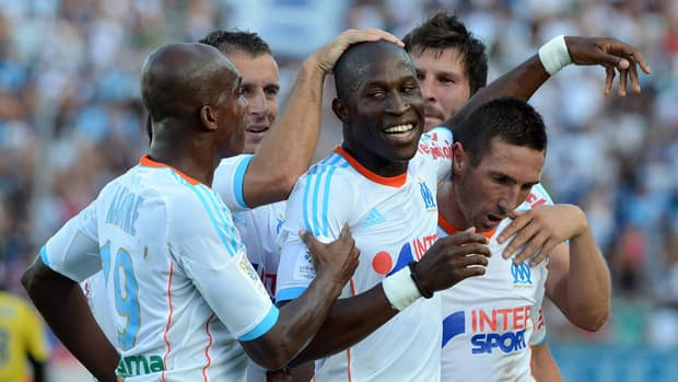 Marseille defender Fanni Rod, centre, is congratuled by teammates after scoring a goal against Sochaux at the Velodrome stadium in Marseille.