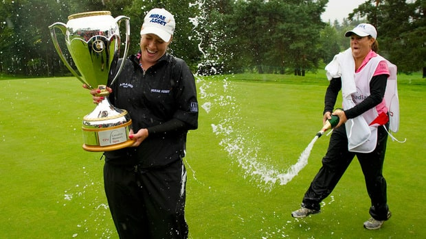 In this 2011 file photo, Brittany Lincicome gets sprayed with champagne by her caddy A.J. Eathorne after winning the CN Canadian Women's Open at the Hillsdale Golf and Country Club in Mirabel, Quebec. The defending champs did not team up for the 2012 tournament.