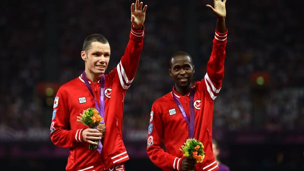 Jason Joseph Dunkerley of Canada and his guide Josh Karanja pose during the medal ceremony for the Men's 1500m - T11 on September 3, 2012 in London, England.