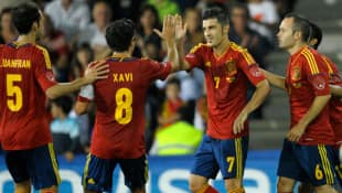 Spain's striker David Villa, centre, celebrates with teammates after scoring a goal during the friendly football match between Spain and Saudi Arabia on Friday.