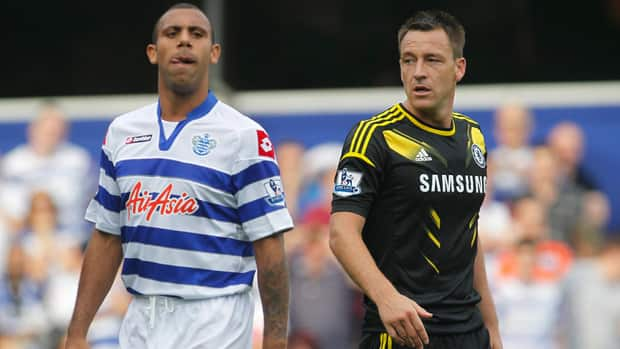 Queens Park Rangers' Anton Ferdinand, left, refused to shake the hand of Chelsea's John Terry on Saturday prior to their soccer match at Loftus Road Stadium in London.