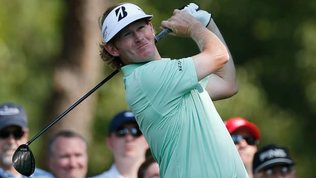 Brandt Snedeker watches his tee shot on the 14th hole during the third round of the Tour Championship on Saturday.