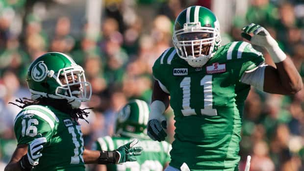 Saskatchewan Roughriders defensive back Eddie Russ ,left, and defensive end Odell Willis celebrate a sack against the Calgary Stampeders during the first quarter in Regina on Sunday.