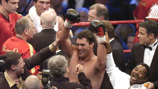 Corrie Sanders, centre, shocked Wladimir Klitschko, top, to win the WBO heavyweight title in 2003.