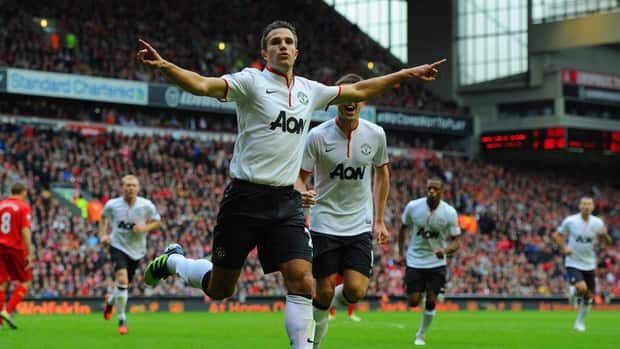 Robin van Persie of Manchester United celebrates scoring against Liverpool at Anfield on September 23, 2012 in Liverpool, England.