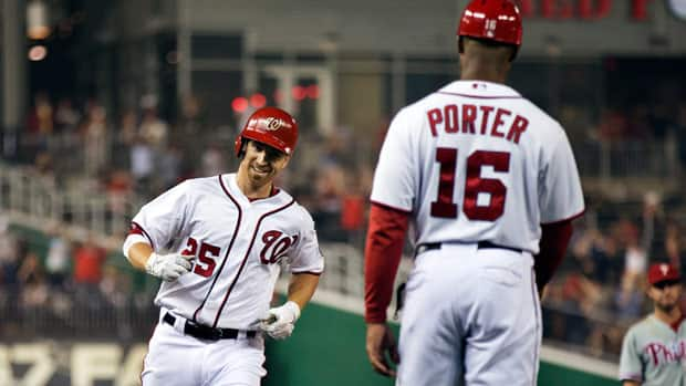 Washington's Adam LaRoche rounds the bases after hitting a home run as third base coach Bo Porter watches during the sixth inning on Tuesday.