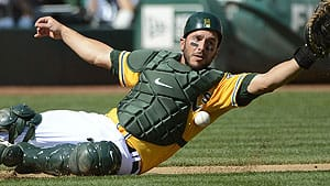 Athletics catcher George Kottaras will aim to improve on his 0-for-8 performance with Milwaukee in the 2011 post-season when his upstart club begins its showdown with hometown Detroit Tigers on Saturday.