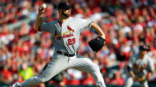 St. Louis Cardinals starting pitcher Chris Carpenter throws to the Washington Nationals in the sixth inning of Game 3 of the National League division baseball series on Wednesday.