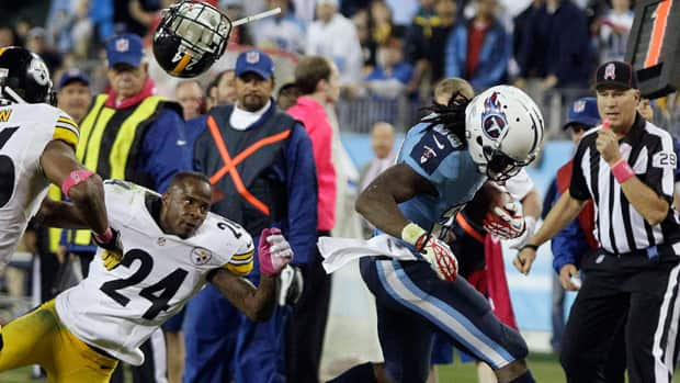 Pittsburgh Steelers cornerback Ike Taylor loses his helmet as he chases Tennessee Titans running back Chris Johnson out of bounds during the second half in Nashville on Thursday.
