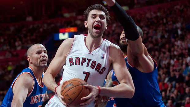 Toronto Raptors' Andrea Bargnani drives to the net against New York Knicks' Jason Kidd and Tyson Chandler on Friday night.