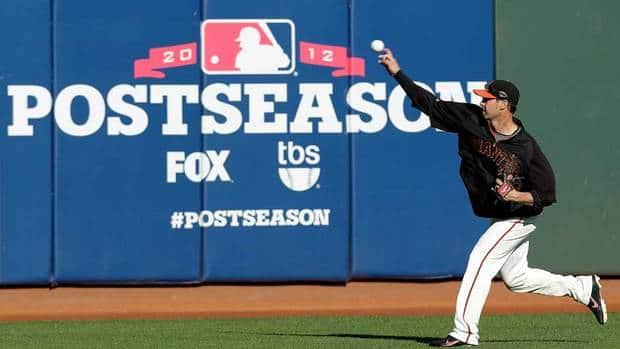 San Francisco Giants' Ryan Vogelsong pitches during a voluntary workout on Saturday in preparation for Game 6 of the NLCS against the St. Louis Cardinals. Vogelsong is scheduled to be the starting pitcher for Sunday's game.