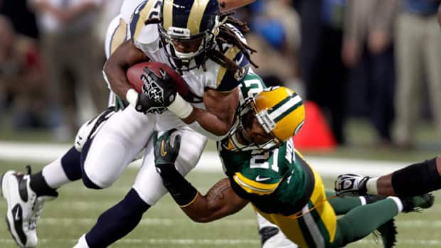 St. Louis Rams running back Daryl Richardson, left, runs with the ball as Green Bay Packers strong safety Charles Woodson defends during the first quarter of Sunday's game.