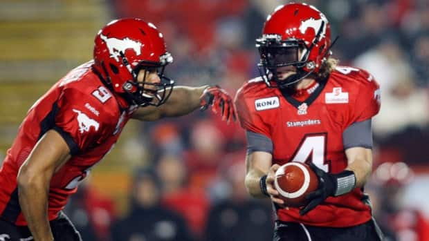 Calgary Stampeders' quarterback Drew Tate, right, fakes a hand-off to teammate Jon Cornish during first quarter action against the B.C. Lions on Friday, Oct. 26, 2012.