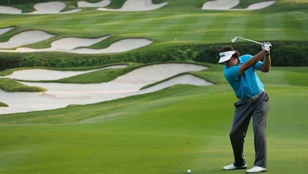 Phil Mickelson tries to avoid several bunkers in Wednesday's pro-am at Mission Hills Resort.