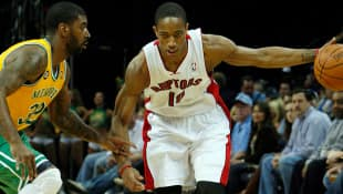 In this photo, guard DeMar Derozan goes to the hoop for the Toronto Raptors as he will continue to do for the next four seasons after signing a contract extension.