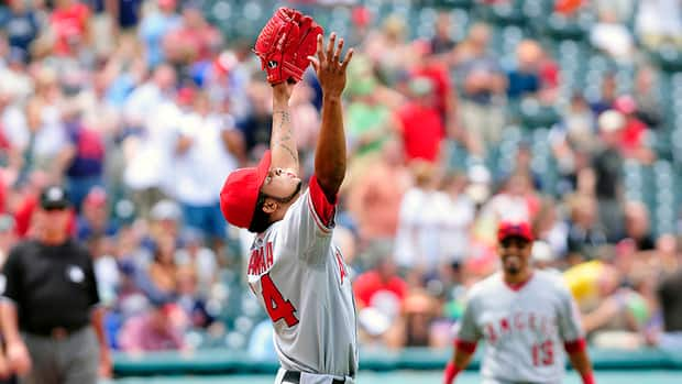 In this photo, starting pitcher Ervin Santana of the Los Angeles Angels throws up his arms in celebration after finishing a no-hitter against the Cleveland Indians on July 27, 2011 at Progressive Field in Cleveland, Ohio.