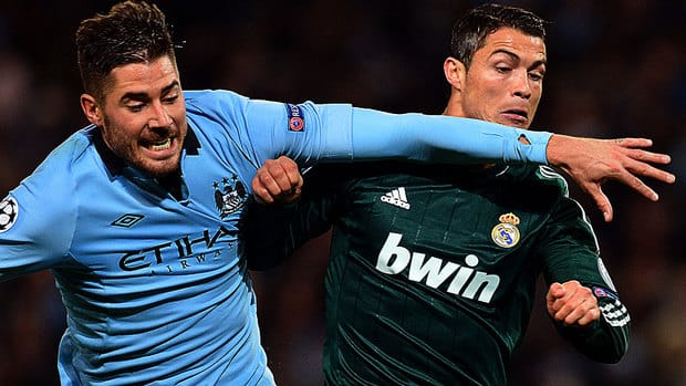 Real Madrid forward Cristiano Ronaldo, right, vies with Manchester City midfielder Javi Garcia during a Champions League group D match Wednesday. The two sides drew 1-1 but it was enough for Real Madrid to advance to the knockout phase.