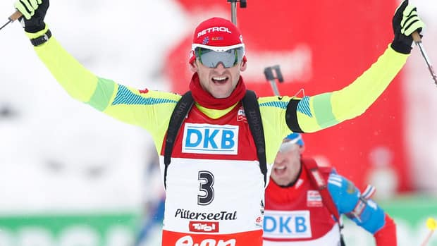 Slovenia's Jakov Fak celebrates after winning the 12,5km pursuit event at the IBU biathlon World Cup on December 8, 2012 in Hochfilzen, Austria.