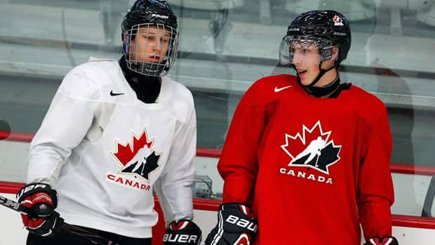 Young Nathan MacKinnon, left, has been assigned a roommate with NHL experience, Ryan Nugent-Hopkins of the Edmonton Oilers.
