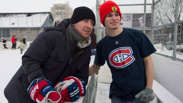 Canadiens defenceman Josh Gorges, left, used Twitter to organize a Boxing Day outdoor hockey game with fans at a neighbourhood rink in Montreal.