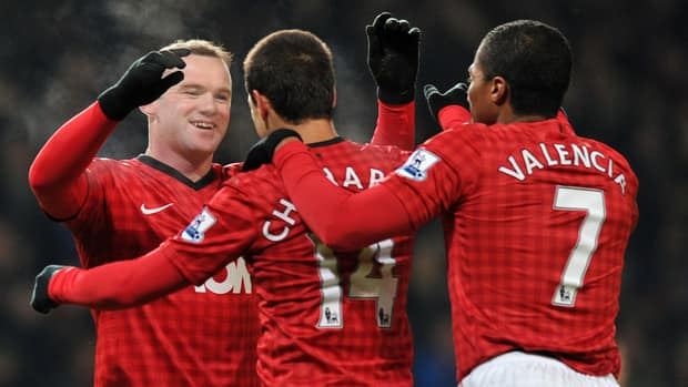 Manchester United's Wayne Rooney, left, celebrates with teammates after scoring against West Ham United at Old Trafford on January 16, 2013.