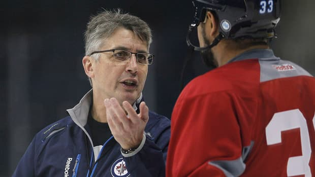 Winnipeg Jets head coach Claude Noel, left, talks with defenceman Dustin Byfuglien during a practice in Winnipeg on Tuesday.