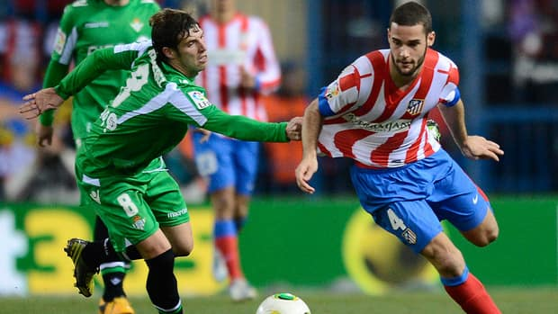 Atletico Madrid's midfielder Mario Suarez, right, vies with Betis' midfielder Ruben Perez during their Spanish Copa del Rey quarter-final match on Thursday.
