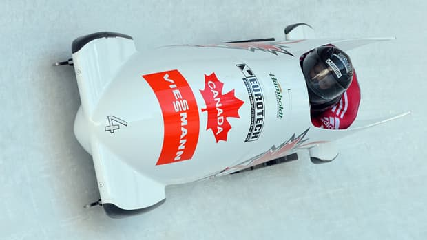 Canada's Rush Lyndon and Lascelles Brown speed down the track during the two-man bobsled race on Saturday in Igls, Austria