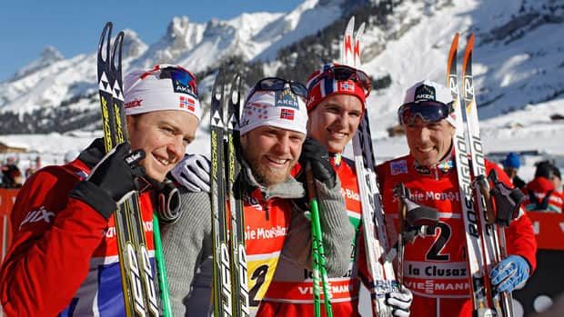 From left, Sjur Roethe, Martin Johnsrud Sundby, Didrik Toenseth, and Eldar Roenning of Norway celebrate after winning the men's cross country team relay race at the La Clusaz' World Cup event, France, on Sunday.