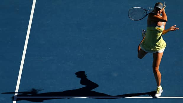 Maria Sharapova unleashes a forehand at twilight in Tuesday's 6-2, 6-2 win at Melbourne