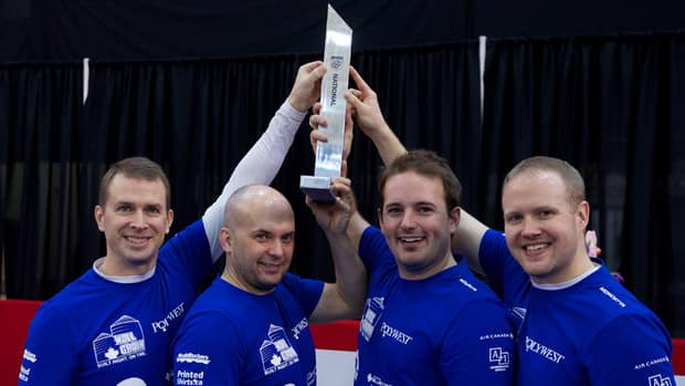 Jeff Stoughton, left, and his team captured the National Grand Slam of Curling championship with an 8-2 win over Mike McEwen on Sunday in Port Hawkesbury, N.S., on Sunday.