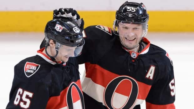 Ottawa Senators defenceman Sergei Gonchar, right, celebrates his game-winning third period power play goal with fellow rearguard Erik Karlsson, against the Washington Capitals in Ottawa on Tuesday night.